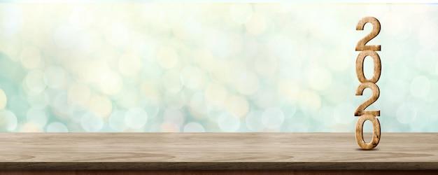 Feliz ano novo 2020 madeira com estrela cintilante na mesa de madeira marrom com fundo verde bokeh