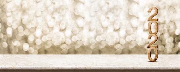 Feliz ano novo 2020 madeira com estrela cintilante na mesa de mármore com fundo dourado bokeh