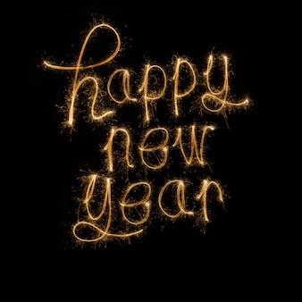 Feliz ano novo, escrito com fogo de artifício de brilho