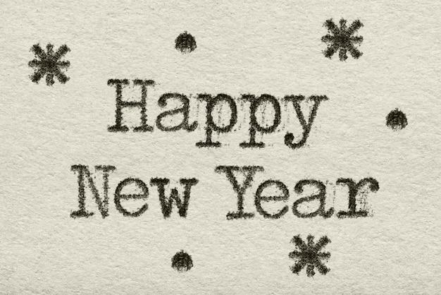 Feliz ano novo palavras impressas com máquina de escrever