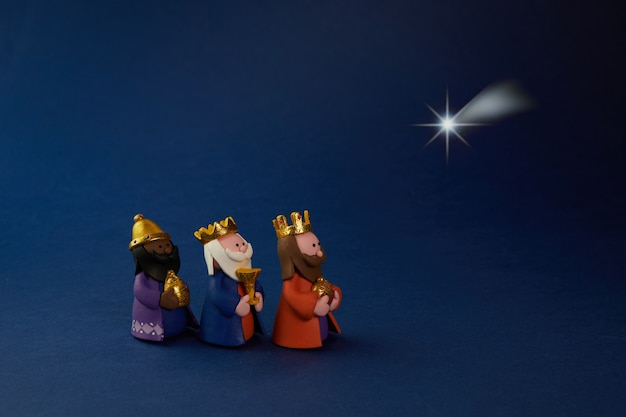 Feliz dia da epiifania. três sábios estrela da formiga no azul