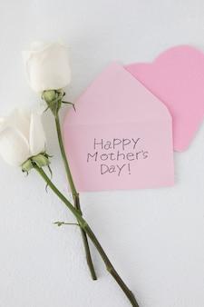 Feliz dia das mães inscrição com duas rosas