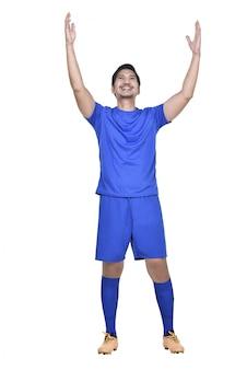 Feliz, jogador de futebol asiático posando comemorar