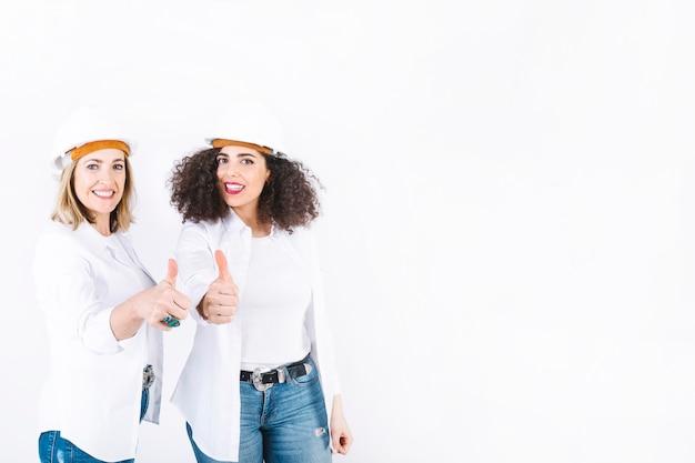 Femininas, engenheiros, gesticule, polegar cima