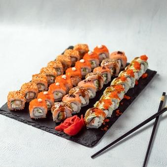 Feng shui roll, kani hot sushi roll com philadelphia roll close up