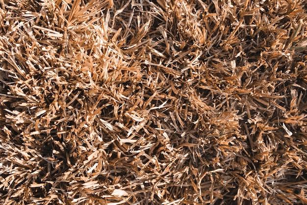 Feno inoperante, fundo da textura do feno da grama de brown.