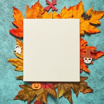 Feriado de halloween com fundo de teia de aranha com folhas e folhas brancas, abóbora, fantasma, espantalho, caveira, bruxa
