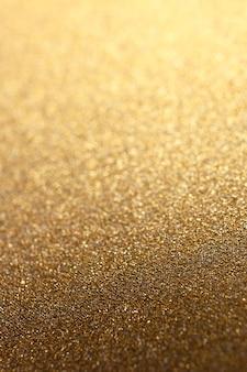 Férias douradas brilham com um fundo brilhante com foco seletivo