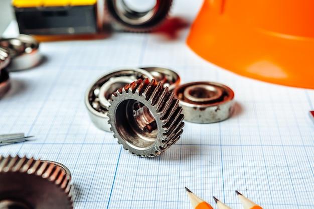 Ferramentas de engenharia de carro vista superior em papel milimetrado