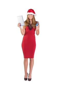 Festive blonde shopping online com tablet