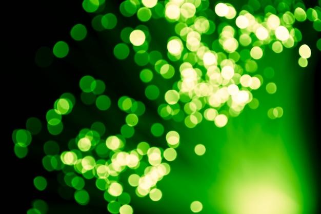 Fibra óptica de luzes verdes desfocadas