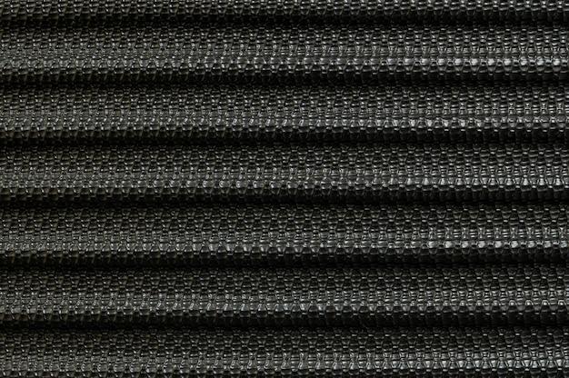Fibra preta velha de superfície do close up no fundo da textura da bagagem