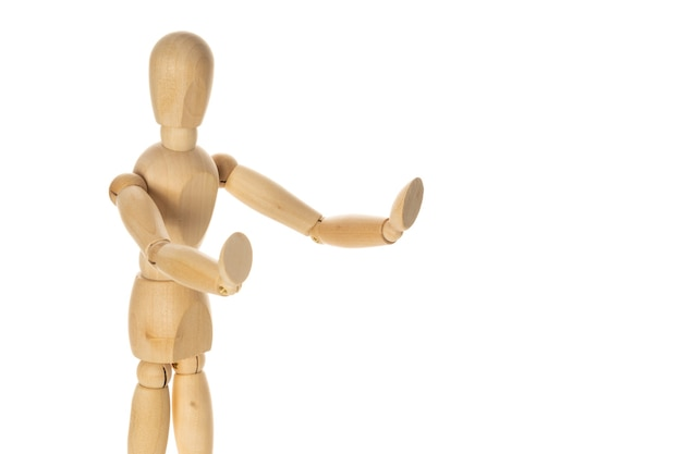 Figura de madeira fazendo gesto de parada com a mão