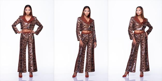 Figura de snap de comprimento total de mulher asiática jovem pele bronzeada alta moda usa vestido sexy de design de padrão de pele de cobra. iluminação de estúdio com fundo branco isolado, conceito de pacote de grupo de colagem