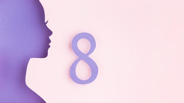 Figura feminina de papel lateralmente - dia da mulher