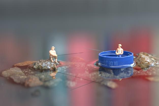 Figura pescador em miniatura
