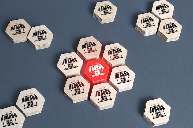 Figuras com símbolos de loja são combinadas em uma montagem.