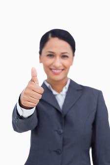 Fim, cima, polegar, cima, sendo, dado, sorrindo, saleswoman