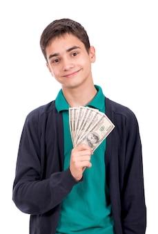 Financeiro, planejamento, infância e conceito - sorridente menino segurando o dinheiro do dólar nas mãos sobre o fundo branco.