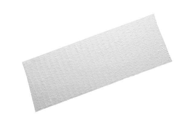 Fita adesiva cinza, pedaço colado isolado no fundo branco com traçado de recorte