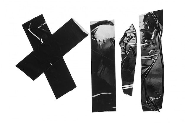 Fita adesiva preta de tamanho diferente rasgada, peças adesivas