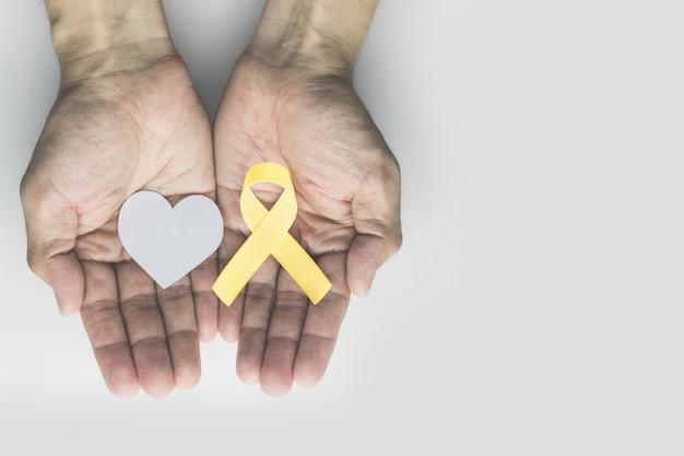 Fita de ouro de conscientização de câncer de infância