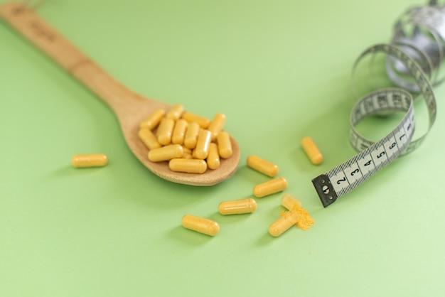 Fita métrica e pílulas