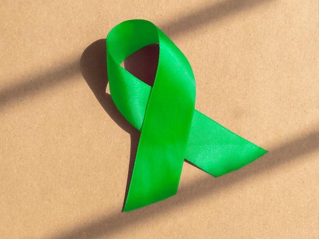 Fita verde como símbolo do dia da consciência mental