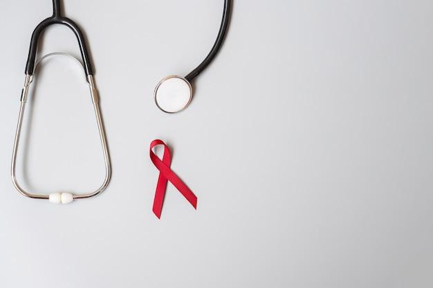 Fita vermelha da borgonha para o dia mundial da aids