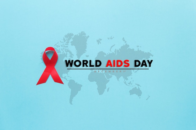 Fita vermelha de conscientização da aids. dia mundial da aids e conceito de saúde e medicina