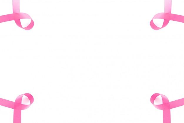 Fitas de cetim rosa, símbolo de apoio à campanha de conscientização do câncer de mama em outubro, em branco