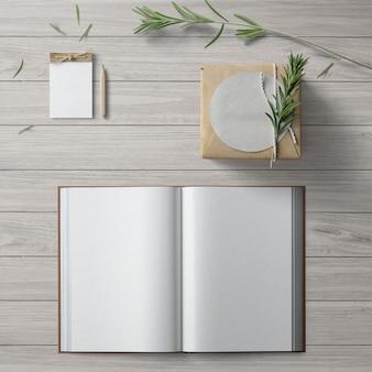 Flatlay minimalista com um bloco de notas e livro aberto