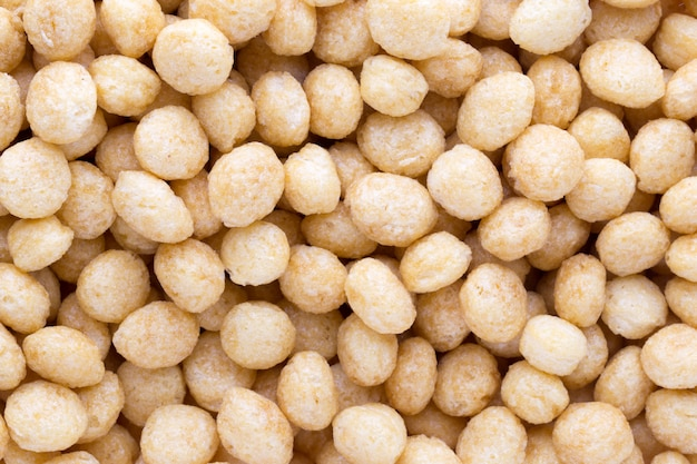 Flocos de milho no close up como pano de fundo.