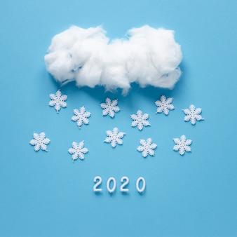 Flocos de neve feitos à mão e nuvem