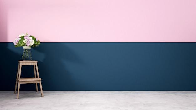 Flor em um vaso no banquinho com parede azul escuro