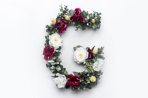 Flor letra g monograma floral foto gratuita