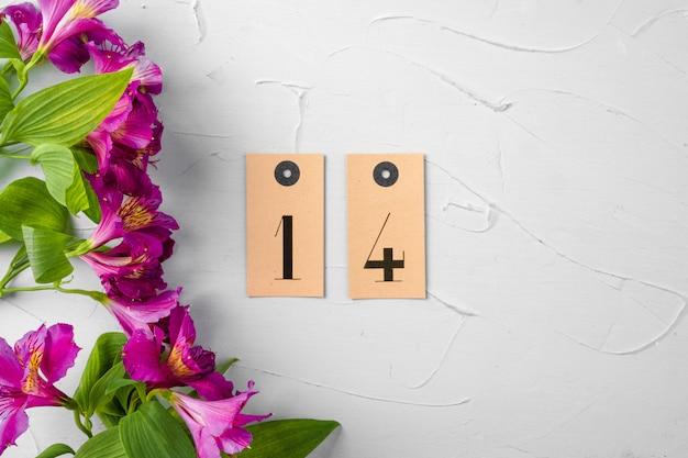 Flores frescas com o número 14