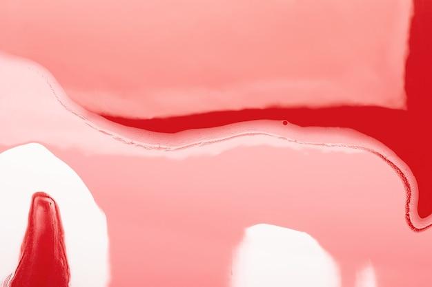 Fluid art. ondas vermelhas em fundo rosa.