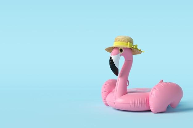 Flutuador de flamingo no conceito mínimo de parede azul.