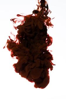 Fluxo vermelho escuro de tinta