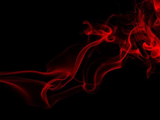 Fogo do sumário vermelho do fumo no fundo preto para o projeto. conceito de escuridão