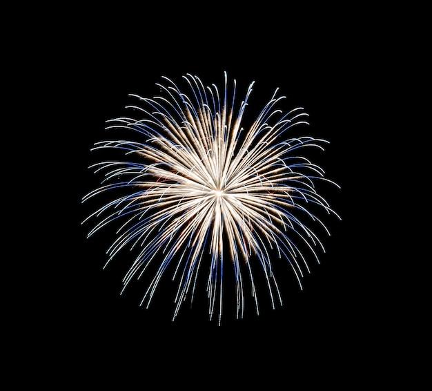 Fogos de artifício azuis e amarelos isolados em fundo preto