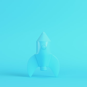 Foguete com estilo de desenho animado sobre fundo azul brilhante em cores pastel. conceito de minimalismo. 3d render