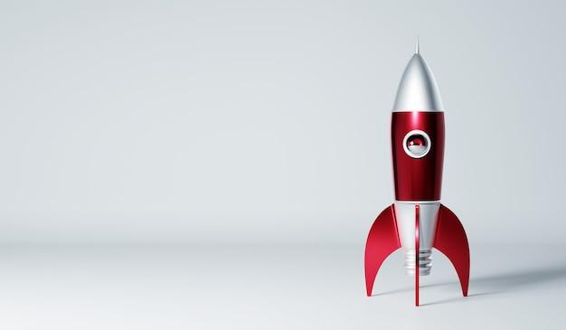 Foguete vermelho metálico e estilo antigo de prata isolado no fundo branco. renderização 3d de conceito criativo de inicialização.