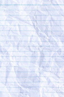 Folha de forro branco do bloco de notas amassado fundo de papel
