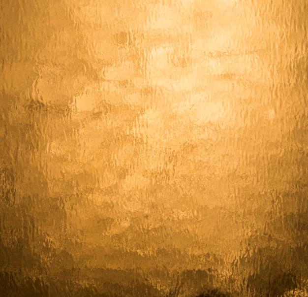 Folha de laranja de fundo dourado