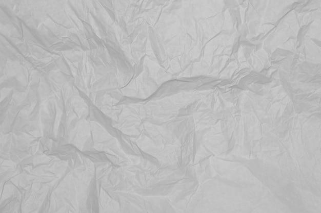 Folha de papel amassada cinza, plano de fundo.