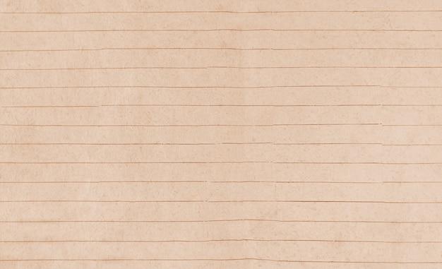 Folha de papel bege velha em linha de fundo