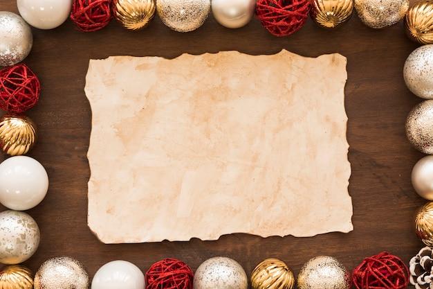 Folha de papel com enfeites brilhantes