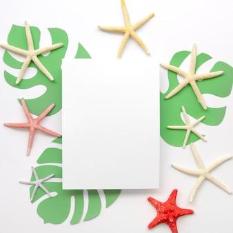 Folha de papel em branco com moldura de estrela do mar